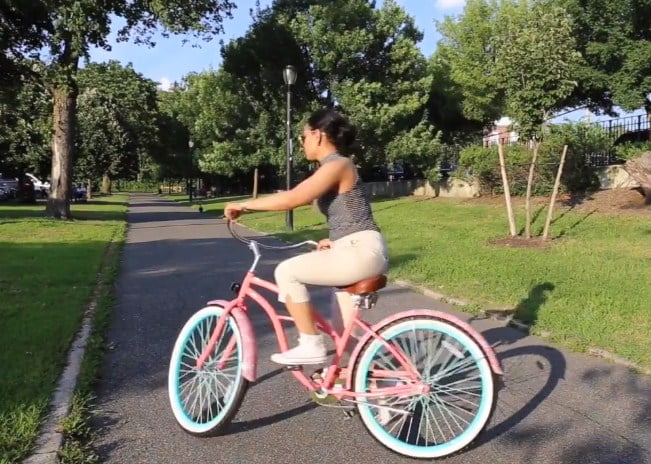 How tall should a woman be to ride a 24 inch bike