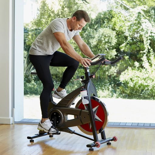 man working out on exercise bike at home 510x510 c ar1 1